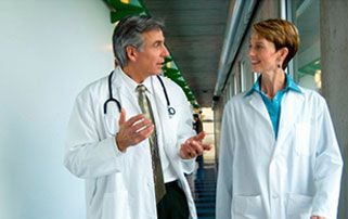 Two physicians walking in discussion